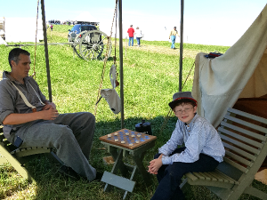 The Ross Clan playing checkers at 2016 Gettysburg